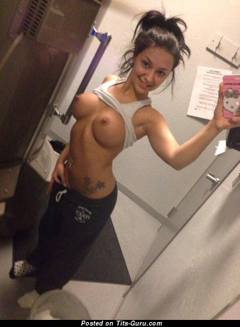 Image. Sexy topless amateur brunette with big fake tots selfie