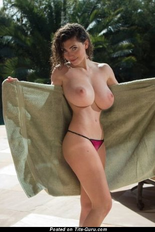 Sexy topless brunette with natural boobies image