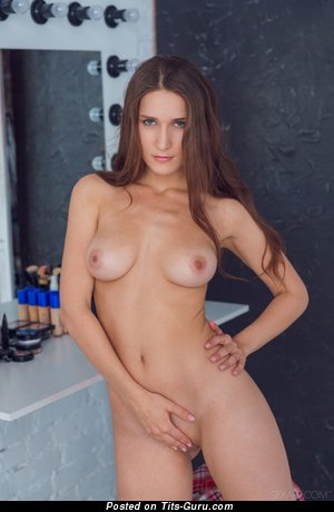 Image. Naked brunette with medium tits picture