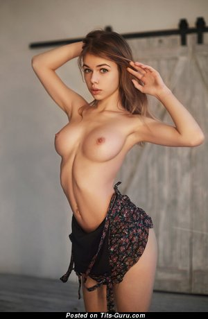 Topless amateur beautiful lady with small natural boobies image