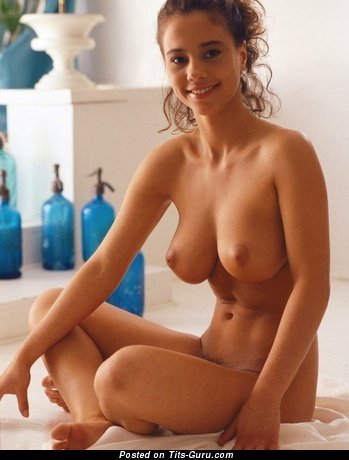 Image. Nude blonde with medium natural tits photo