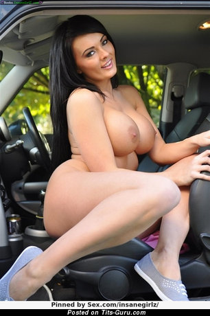Image. Naked brunette with big fake tits photo