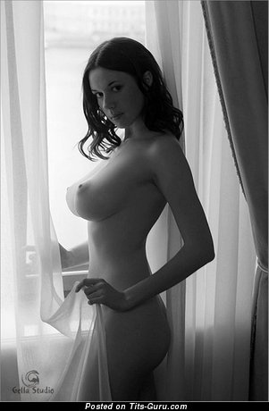 Image. Sexy topless brunette with medium boobies and big nipples vintage