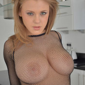 Sexy topless beautiful woman with medium natural tittes and big nipples image