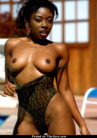Naked ebony with small natural breast image