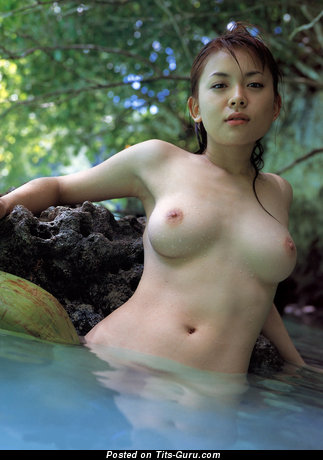 Wet naked asian red hair with medium natural tits picture