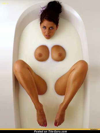 Image. Wet naked brunette with big tots photo