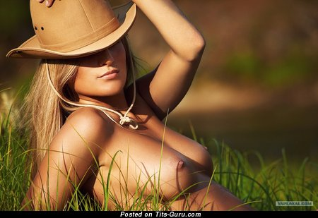 Image. Nude blonde with medium natural breast picture