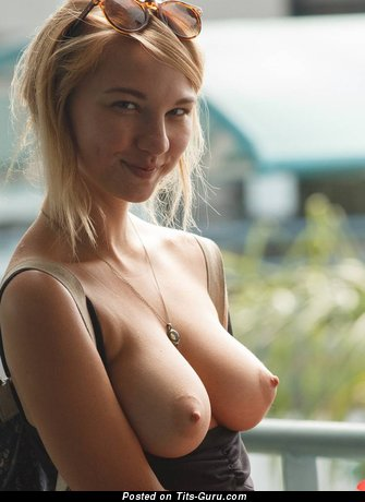 Topless blonde with medium natural breast pic