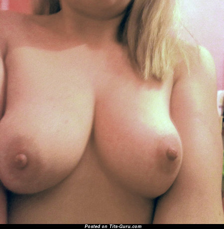 Sexy topless amateur blonde with medium natural tittys & big nipples pic