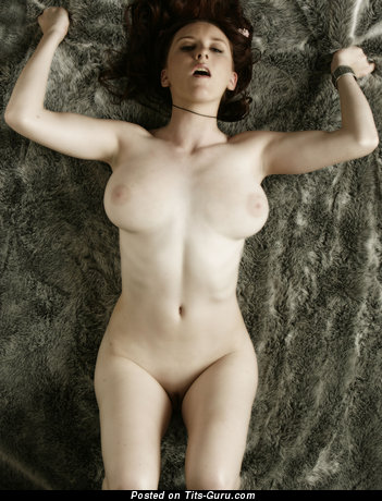 Naked brunette with natural tots image