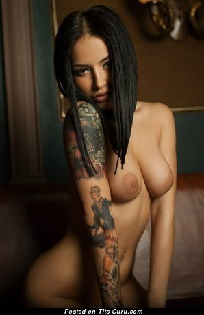 Image. Nude brunette with medium breast and tattoo pic