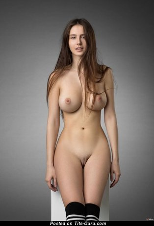 Image. Sexy naked beautiful lady with medium natural tittes photo