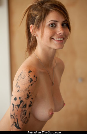 Image. Topless brunette with medium natural breast photo