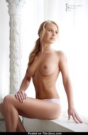 Image. Blonde with medium natural tittes photo