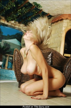 Image. Naked blonde with medium natural boob pic