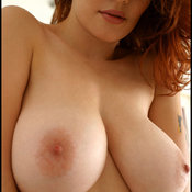Danielle Riley - red hair with big boobs image