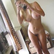 Sexy topless amateur blonde with medium natural boobies selfie
