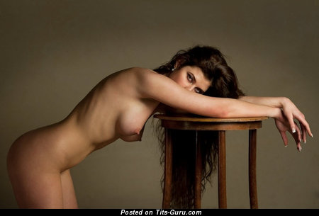 Image. Naked wonderful woman with medium natural breast photo