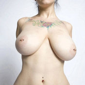 Amateur amazing woman with huge natural tittys and tattoo picture