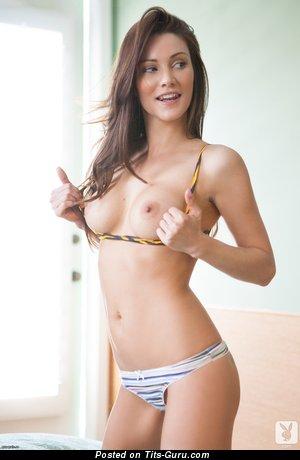 Erika Knight - naked red hair with medium tits photo