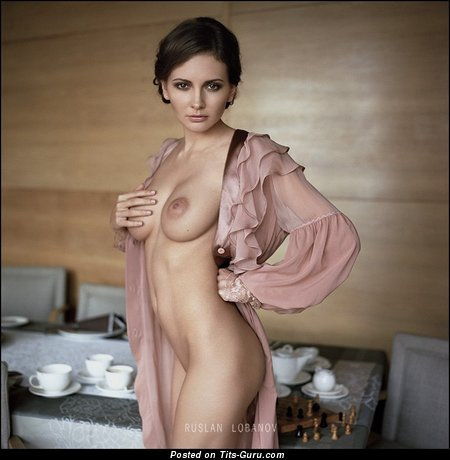 Nude awesome woman with medium natural tittes photo