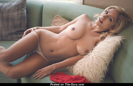 Image. Topless blonde with medium natural boob picture