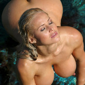 Sexy wet naked blonde with big boobies and big nipples photo