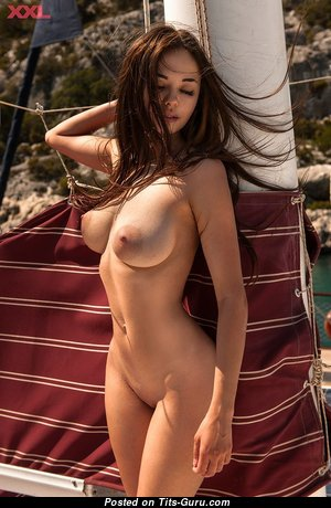 Lovely Glamour Brunette with Lovely Nude Natural Soft Hooters on the Beach (18+ Image)