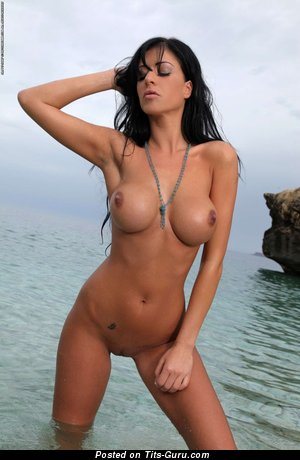 Image. Ella Mai - sexy nude brunette with big fake breast image