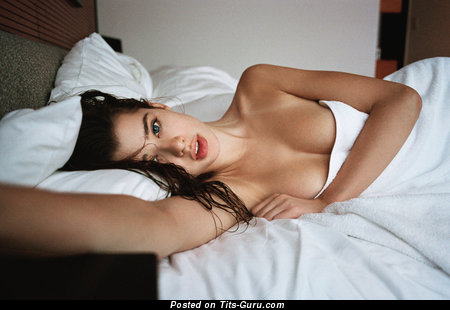 Topless brunette photo