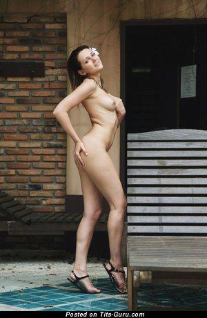 Nude brunette with medium boobies pic