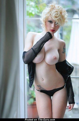 Image. Natasha Legeyda - sexy naked blonde with big breast and tattoo image
