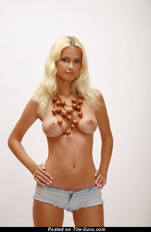 Nude beautiful female with medium natural tittes picture