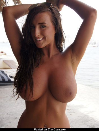 Image. Sexy topless brunette with big natural boobies and big nipples image