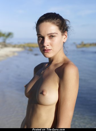Image. Brunette with medium natural boobs and big nipples pic