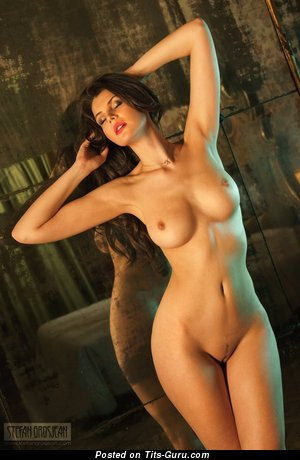 Image. Naked nice female with medium tits photo