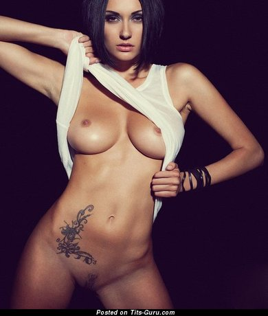 Image. Naked nice woman with medium natural boob and tattoo pic