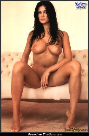 Image. Manuela Arcuri - sexy topless brunette with medium natural boobies picture