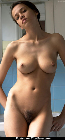 Image. Nude brunette with medium boob photo