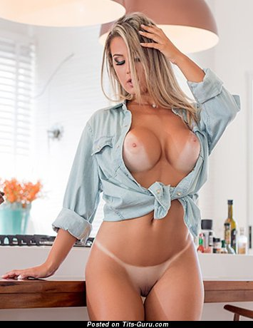 Image. Nude beautiful woman with fake boobs photo