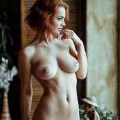 Red hair with medium natural boobs image