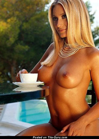 Pretty Blonde with Pretty Naked Firm Boobs in the Pool (Xxx Photo)
