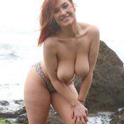 Topless red hair with big natural tittys and tattoo picture