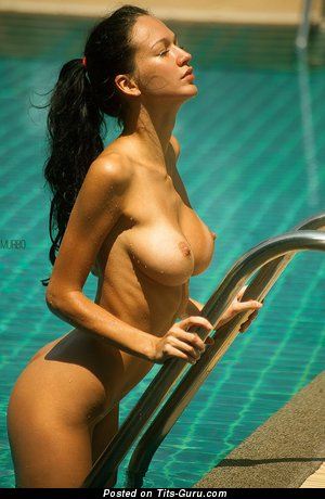 Image. Sexy topless amateur brunette with medium natural tittes pic
