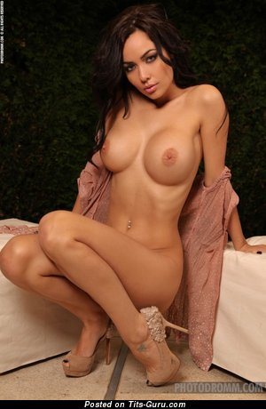 Naked brunette with big fake breast picture