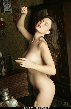 Betcee - nude brunette with medium natural tittes picture