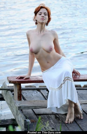 Image. Beautiful female with natural tittes photo