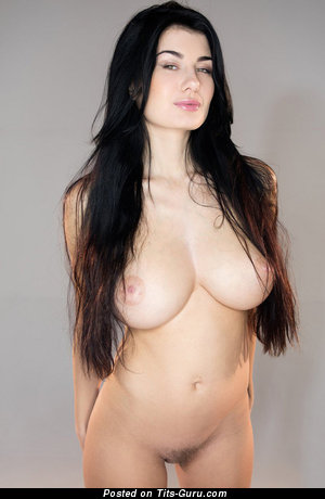 Image. Nude brunette with big natural tittes image