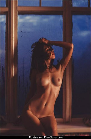 Nude wonderful lady with medium natural tots photo